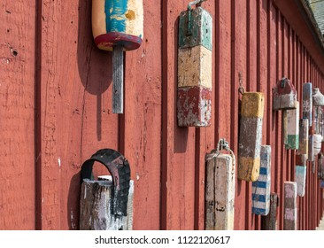 Lobster buoys on a red fishing shack in Rockport, Massachusetts.
