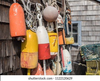 Lobster buoys and traps on a weathered fishing shack in Rockport, Massachusetts.