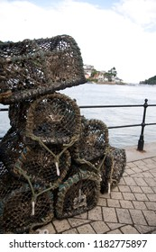 Lobster Cages stacked up in Dartmouth, UK