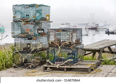 Lobster and crab pots on a dock in Maine