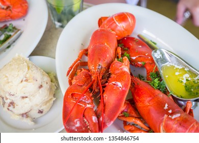 Lobster dinner with potato salad and butter