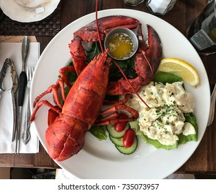 Lobster dinner with potato salad and drawn butter