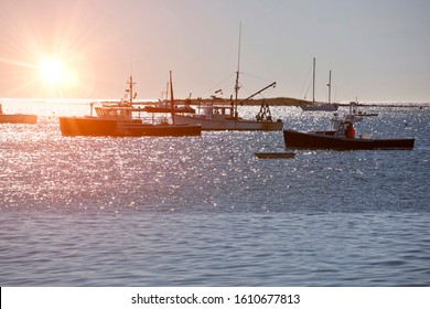 Lobster fishing boats in Maine, New England, USA. Focus is on foreground and boat on the right.