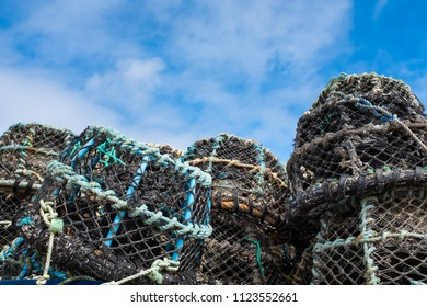 Lobster fishing pots stacked in St Ives harbour. In St Ives, Cornwall, England.