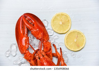 Lobster food on ice seafood shrimp with lemon on white wooden background on top view
