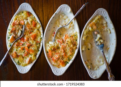 Lobster Mac N cheese. Classic American bar appetizer, loaded Mac n cheese. Macaroni mixed with melted cheddar cheese, grilled Cajun shrimp, crispy bacon, jalapeños, spicy corn salsa, and cilantro.