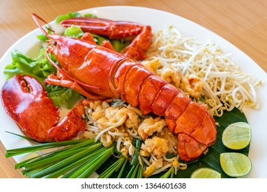 Lobster Pad thai, stir fried Thai rice noodle pasta with whole lobster and lobster meat.