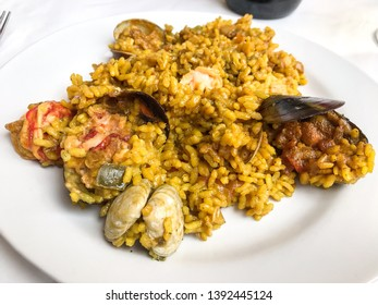 Lobster paella, prawns, clams and mussels