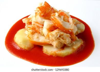 lobster with potatoes and tomato sauce
