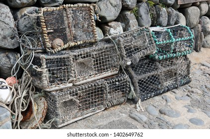 Lobster pots on Clovelly Harbour wall