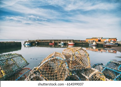 Lobster pots stacked onto each other in a small fishing port. Port Seaton, Scotland, UK