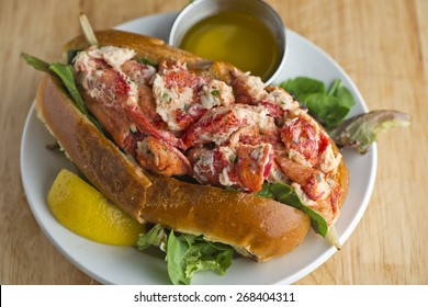 Lobster Roll. Traditional classic American Sandwich. New England classic, fresh Maine Lobster boiled, mixed with mayo, celery, chives served in toasted hero roll with crisp lettuce and drawn butter.