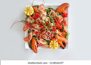 Lobster salad on white background, selective focus.Catalan lobster.Top view.