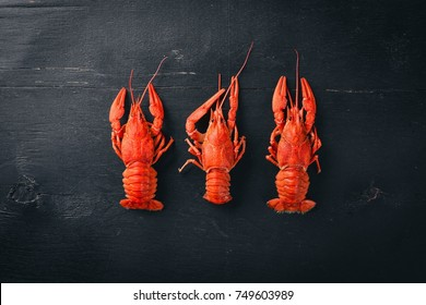 Lobster. Seafood. On a wooden background. Top view. Free space for your text.
