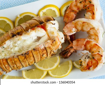 Lobster tail and jumbo shrimps with lemon and butter.
