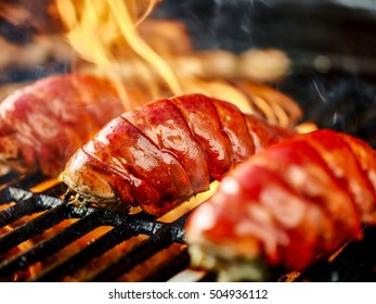 lobster tails being grilled close up