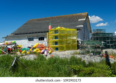 Lobster traps and buoys piled up in the seaside village of Peggy's Cove, Nova Scotia, Canada.