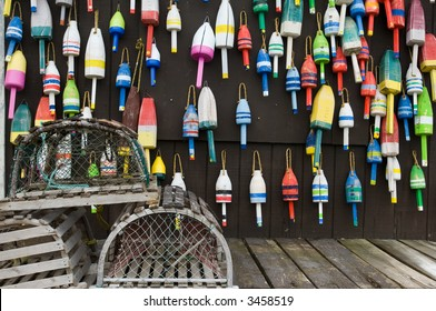 Lobster traps and colorful buoys on fisherman's house in coastal Maine