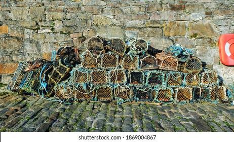 Lobster traps on the Harbour of Cellardyke Scotland UK