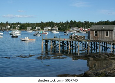 Lobster traps on wharfs	with harbor in background, Mount Desert Island, Acadia National Park,	Bernard 	Maine