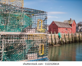 Lobster traps and rope on a fishing pier in Rockport, Massachusetts.