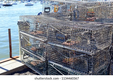 Lobster traps stacked at harbor dock, common coastal scene on the East Coast and New England in America