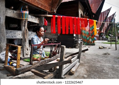 A local artisant from Batak tribe in Samosir Island, Toba Lake, North Sumatra Province Indonesia still preserve the traditional processing to make fabric called ulos (2018). Its also cultural village.