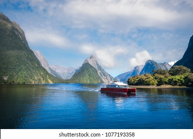 A local boat at Freshwater Basin at Milford Sound in the morning, going towards Southern Discoveries Marina. Milford Sound is a fjord and the most beautiful natural feature of New Zealand South Island