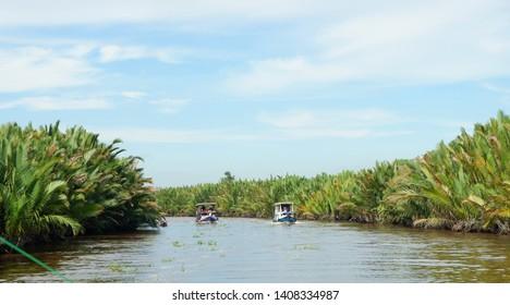 Local boat 'klotok'  on Sekonyer River into Tanjung Puting Jungle, Borneo, Indonesia