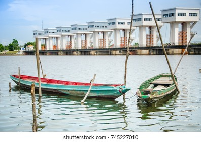 Local boats's Thailand with architecture building of Uthokwipat Prasit Watergate background for prevent seawater intrusion enter the river at Pak phanang, Nakhon Si Thammarat province, Thailand.