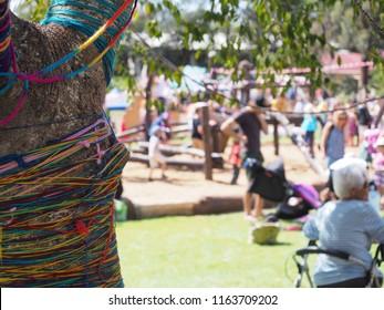 Local brightly coloured tree at school art festival