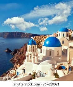 Local church with blue cupola in Oia village, Santorini island, Greece, panoramic image