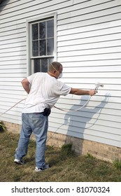 Local contractor painting outside of house, business is booming in summer months