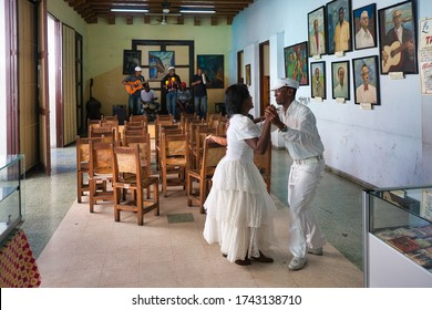A local couple do an impromptu dance to the music of musicians in a coffee house in Havana, Cuba.  02-12-2019