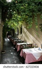 Local cozy restaurant on the street of the city. Santorini
