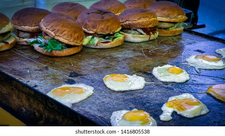 A local delicacy, hanburgers with eggs, sit on a grill at a festival in Shimoda, Japan