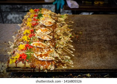 A local delicacy sits on a grill at a festival in Shimoda, Japan