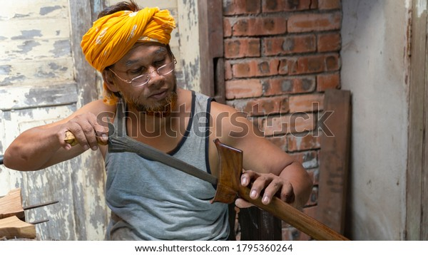 """Local demonstrate on making art of crafting Malay Traditional asymmetrical Dagger called """"Keris"""""""