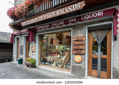 Local food products are on display in the window of a traditional food shop in Valtournache Breuil -  Cervinia, Italy on September 18, 2011