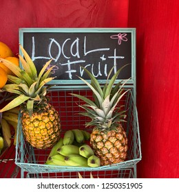 Local Fruit Market with pineapples, bananas, and papayas
