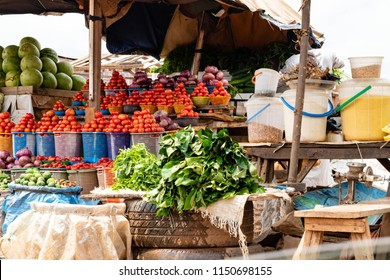 Local grocery market with fruits vegetables in Nigeria. Vegetables at a outdoor market in Abuja