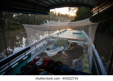 Local 'klotok' boat on Sekonyer River into Tanjung Puting Jungle, Borneo, Indonesia: sleeping on the boat