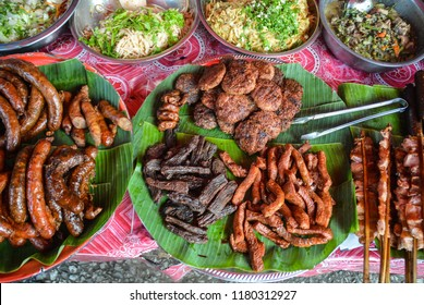 Local Laotian cuisine at the Luang Prabang morning market. Grilled pork sausage (Sai Oua), Beef jerky (Seen hang), Laotian barbeque (seen dat) and noodles