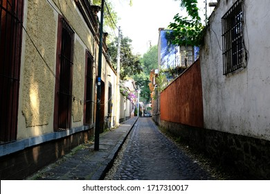 A local long and narrow road in Coyoacán (Place of Coyotes), Mexico City, Mexico.