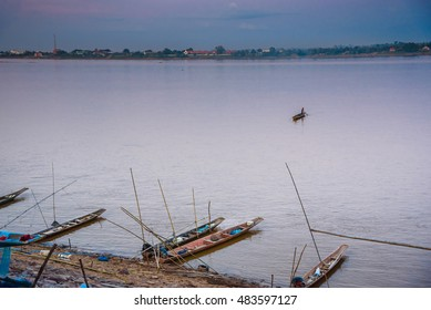 local longtail boats at Kong river with blue and orange sky before sunset