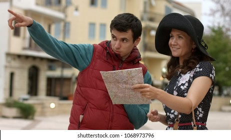 Local male citizen showing direction to beautiful female tourist, travel abroad