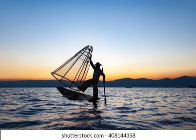 Local man fishing with a net at sunset, Amarapura, Mandalay region, Myanmar