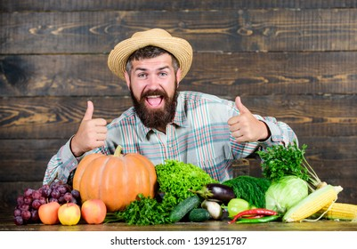 Local market. Homegrown vegetables. Buy vegetables local farm. Farm market harvest festival. Sell vegetables. Man bearded farmer with vegetables rustic style background. Locally grown crops concept.