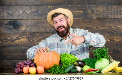 Local market. Locally grown crops concept. Homegrown vegetables. Buy vegetables local farm. Farm market harvest festival. Sell vegetables. Man bearded farmer with vegetables rustic style background.