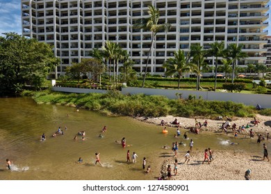Local Mexican children playing in the Cuale river Puerto Vallarta next to an exclusive resort Puerto Vallarta, Mexico - March 13, 2016